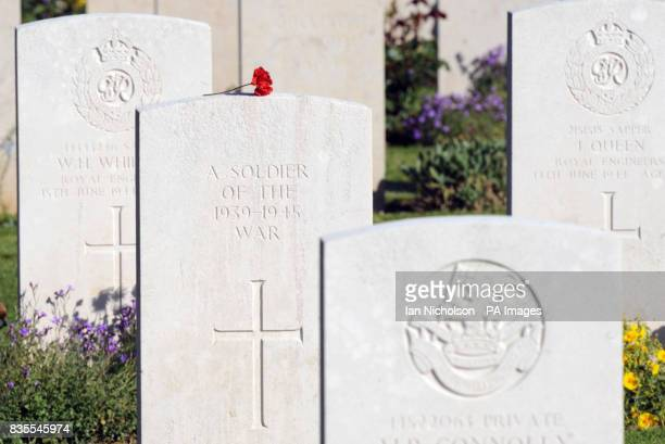 A token left on a gravestone at the Bayeux War Cemetery as veterans of the D Day Landings gather in northern France for 65th anniversary...