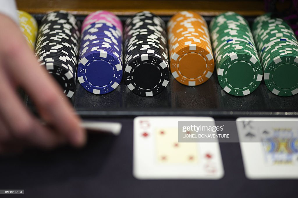 Tokens are pictured as a student of the Cerus Casino Academy, a school for croupiers in Paris, deals out cards on a black jack table on February 27, 2013.