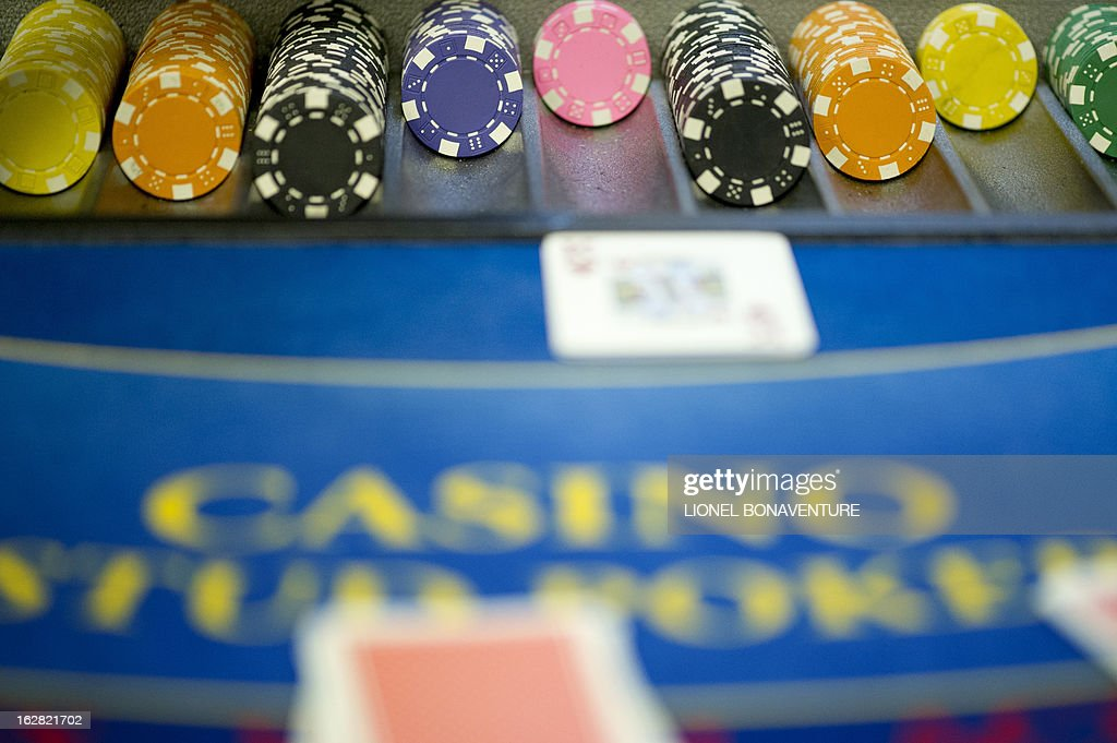 Tokens are pictured on a black jack table in the Cerus Casino Academy, a school for croupiers in Paris, on February 27, 2013.