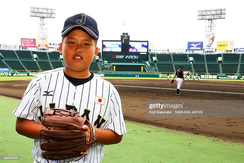 Tokiharu Nishioka of U12 Japan poses for a photograph in the sendoff game between U18 Japan and Collegiate Japan before the 2015 WBSC U18 Baseball...