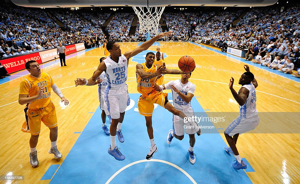 J.P. Tokoto #25 of the North Carolina Tar Heels defends a shot by Shamarr Bowden #20 of the East Carolina Pirates during play at the Dean Smith Center on December 15, 2012 in Chapel Hill, North Carolina. North Carolina won 93-87.
