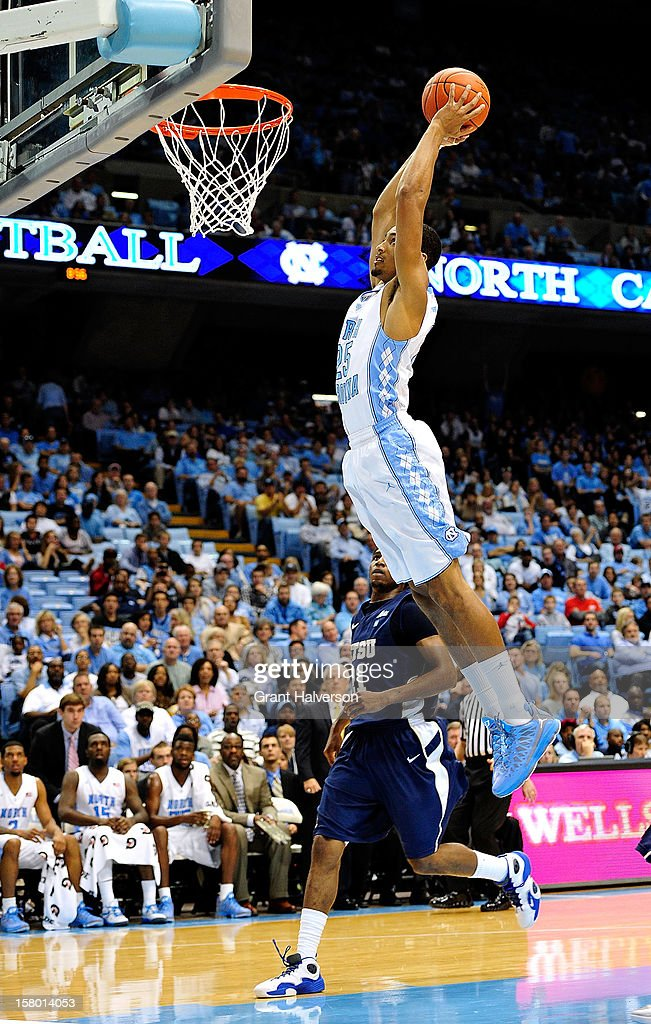 J.P. Tokoto #25 of the North Carolina Tar Heels dunks against the East Tennessee State Buccaneers during play at Dean Smith Center on December 8, 2012 in Chapel Hill, North Carolina. North Carolina won 78-55.