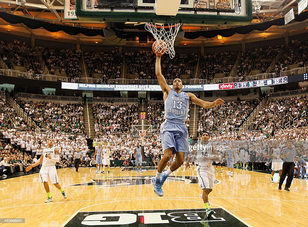 J.P. Tokoto #13 of the North Carolina Tar Heels gets in for a second half dunk while playing the Michigan State Spartans at the Jack T. Breslin Student Events Center on December 4, 2013 in East Lansing, Michigan. North Carolina won the game 79-65.