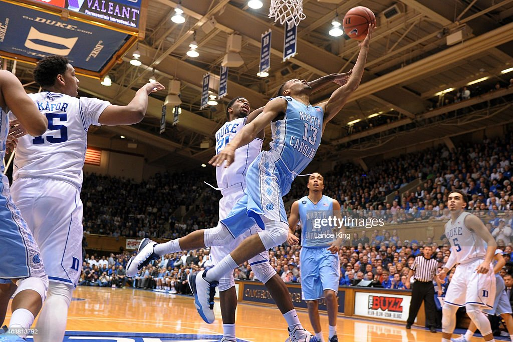 <a gi-track='captionPersonalityLinkClicked' href=/galleries/search?phrase=J.P.+Tokoto+-+Basketball+Player&family=editorial&specificpeople=13908838 ng-click='$event.stopPropagation()'>J.P. Tokoto</a> #13 of the North Carolina Tar Heels goes to the basket against <a gi-track='captionPersonalityLinkClicked' href=/galleries/search?phrase=Amile+Jefferson&family=editorial&specificpeople=7887115 ng-click='$event.stopPropagation()'>Amile Jefferson</a> #21 of the Duke Blue Devils at Cameron Indoor Stadium on February 18, 2015 in Durham, North Carolina.
