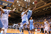 P Tokoto of the North Carolina Tar Heels goes to the basket against Amile Jefferson of the Duke Blue Devils at Cameron Indoor Stadium on February 18...