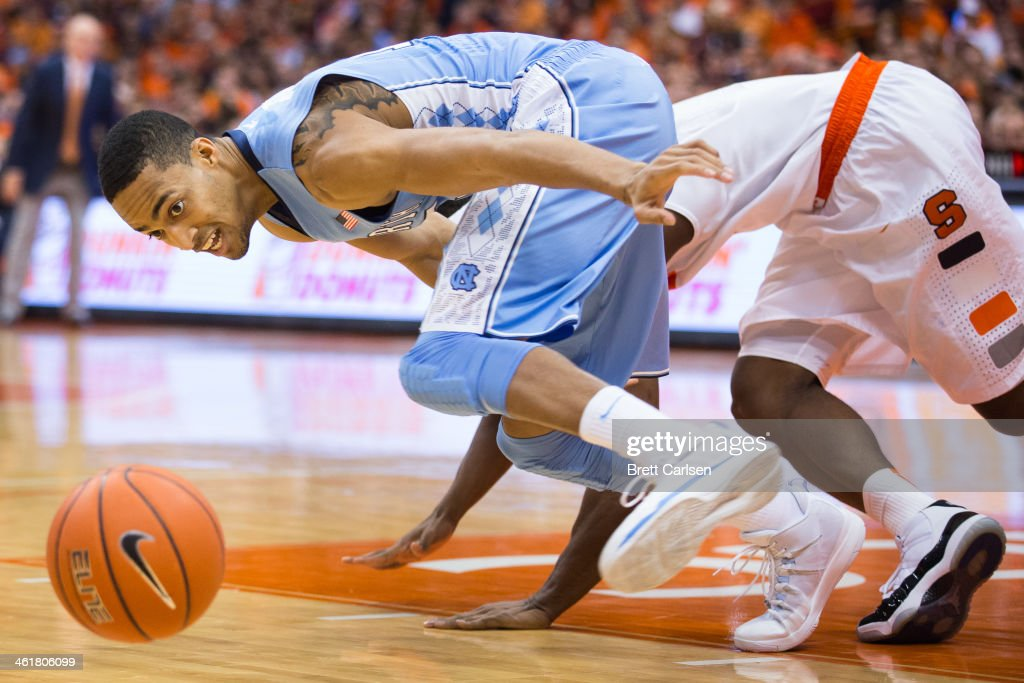 J.P. Tokoto #13 of the North Carolina Tar Heels scrambles for a loose ball stripped from <a gi-track='captionPersonalityLinkClicked' href=/galleries/search?phrase=C.J.+Fair&family=editorial&specificpeople=7366451 ng-click='$event.stopPropagation()'>C.J. Fair</a> #5 of the Syracuse Orange (behind) during the first half on January 11, 2014 at The Carrier Dome in Syracuse, New York.