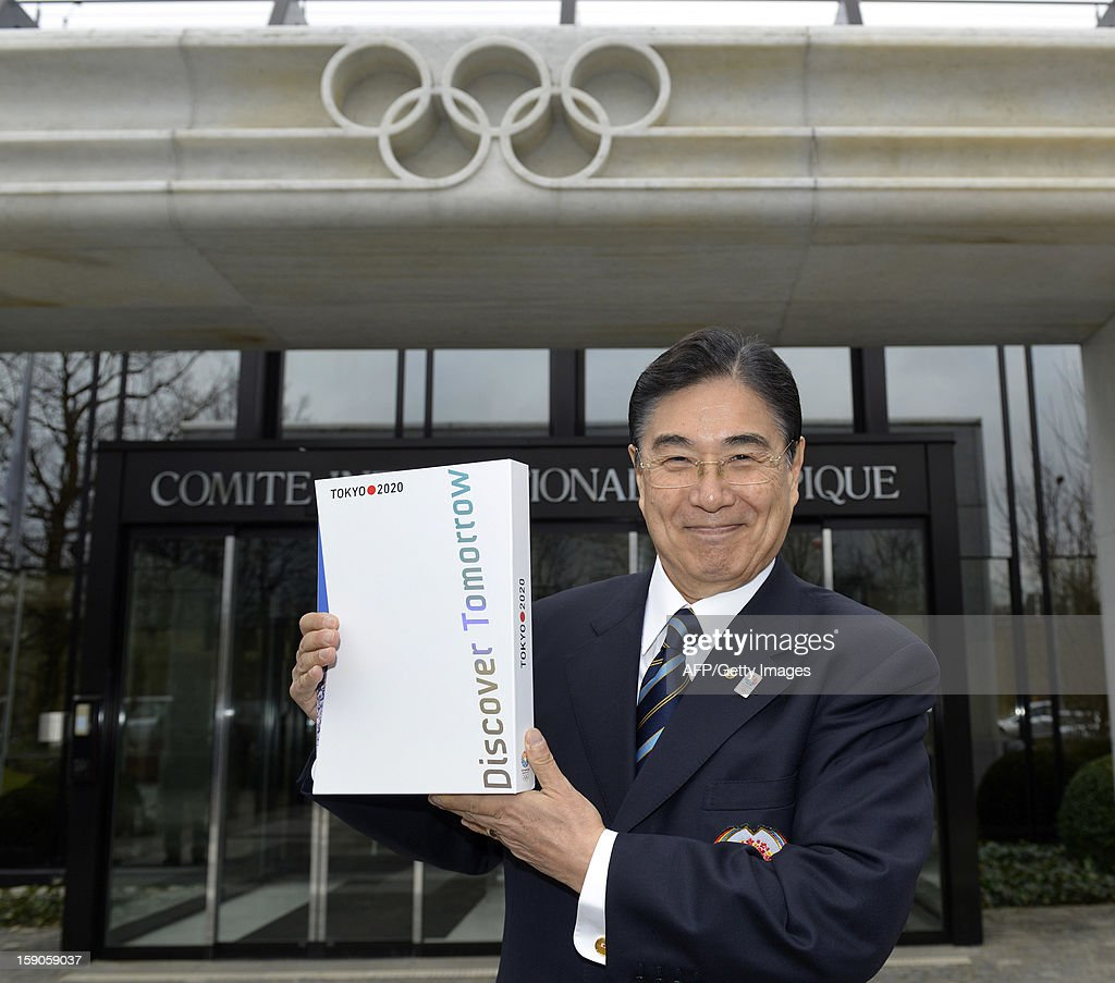 Tokyo 2020 CEO Masato Mizuno poses with the candidature files prior to the handover on January 7, 2013 at the headquarters of the International Olympic Committee in Lausanne. The three candidate cities, Istanbul, Madrid and Tokyo to host the 2020 Olympics take a huge step on the road to who will be designated the winner in Buenos Aires on September 7 when they present their candidature files to the International Olympic Committee on Monday in Lausanne.