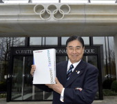 Tokyo 2020 CEO Masato Mizuno poses with the candidature files prior to the handover on January 7 2013 at the headquarters of the International...