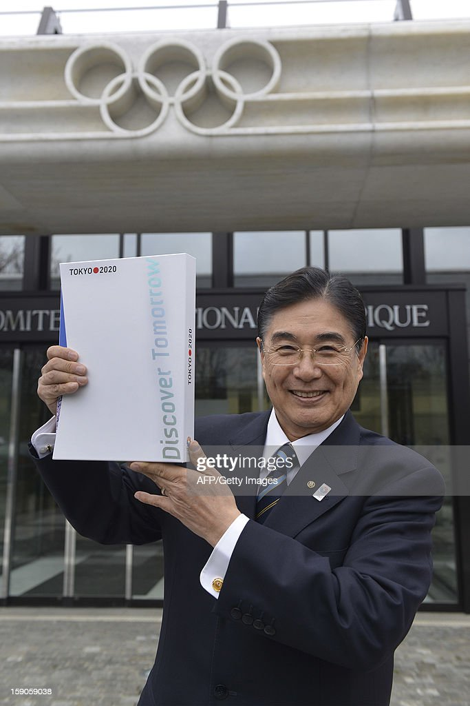 Tokyo 2020 CEO Masato Mizuno poses with the candidature files prior to the handover on January 7, 2013 at the headquarters of the International Olympic Committee in Lausanne. The three candidate cities, Istanbul, Madrid and Tokyo to host the 2020 Olympics take a huge step on the road to who will be designated the winner in Buenos Aires on September 7 when they present their candidature files to the International Olympic Committee on Monday in Lausanne.AFP PHOTO / SEBASTIEN FEVAL