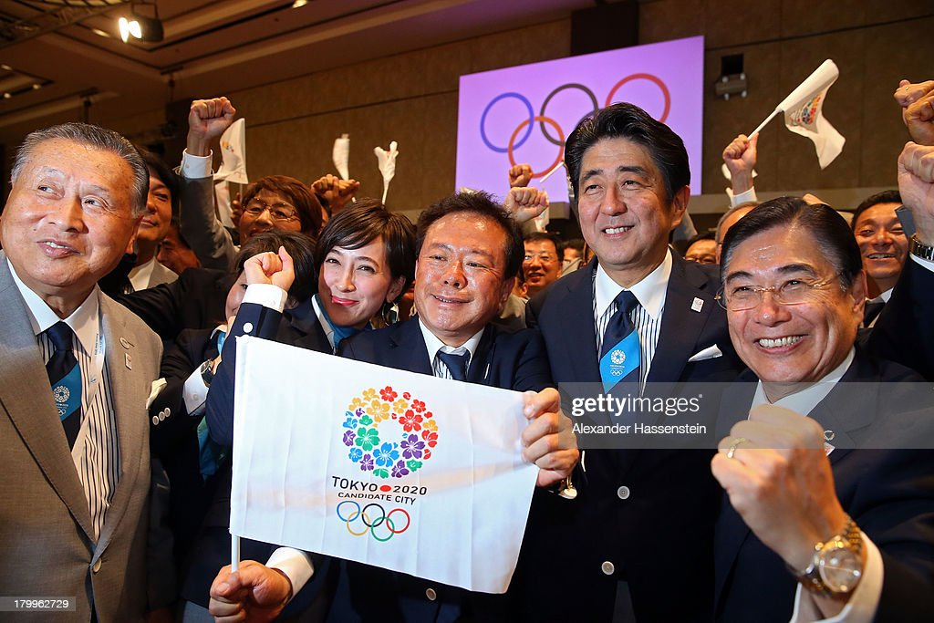 Tokyo 2020 CEO <a gi-track='captionPersonalityLinkClicked' href=/galleries/search?phrase=Masato+Mizuno&family=editorial&specificpeople=714172 ng-click='$event.stopPropagation()'>Masato Mizuno</a>, Prime Minister of Japan <a gi-track='captionPersonalityLinkClicked' href=/galleries/search?phrase=Shinzo+Abe&family=editorial&specificpeople=559017 ng-click='$event.stopPropagation()'>Shinzo Abe</a>, Governor of Tokyo, Naoki Inose and 'Cool Tokyo' Ambassador Christel Takigawa celebrate as Tokyo is awarded the 2020 Summer Olympic Gamesduring the 125th IOC Session - 2020 Olympics Host City Announcement at Hilton Hotel on September 7, 2013 in Buenos Aires, Argentina.