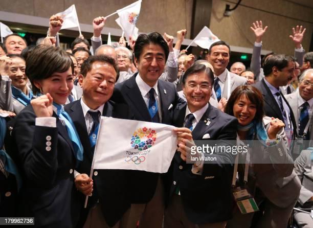 Tokyo 2020 CEO Masato Mizuno Prime Minister of Japan Shinzo Abe Governor of Tokyo Naoki Inose and 'Cool Tokyo' Ambassador Christel Takigawa celebrate...