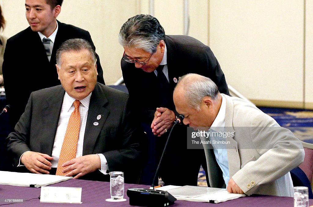 Tokyo 2020 Organising Committeee President <a gi-track='captionPersonalityLinkClicked' href=/galleries/search?phrase=Yoshiro+Mori&family=editorial&specificpeople=217562 ng-click='$event.stopPropagation()'>Yoshiro Mori</a>, Japan Olympic Committee President <a gi-track='captionPersonalityLinkClicked' href=/galleries/search?phrase=Tsunekazu+Takeda&family=editorial&specificpeople=2574573 ng-click='$event.stopPropagation()'>Tsunekazu Takeda</a> and Tokyo Metropolitan Governor <a gi-track='captionPersonalityLinkClicked' href=/galleries/search?phrase=Yoichi+Masuzoe&family=editorial&specificpeople=4473580 ng-click='$event.stopPropagation()'>Yoichi Masuzoe</a> attend the New National Stadium Construction Experts Meeting on July 7, 2015 in Tokyo, Japan. The total construction cost has been raised from 162.5 billion Japanese yen to 250 billion yen, due to the higher labour and material costs.