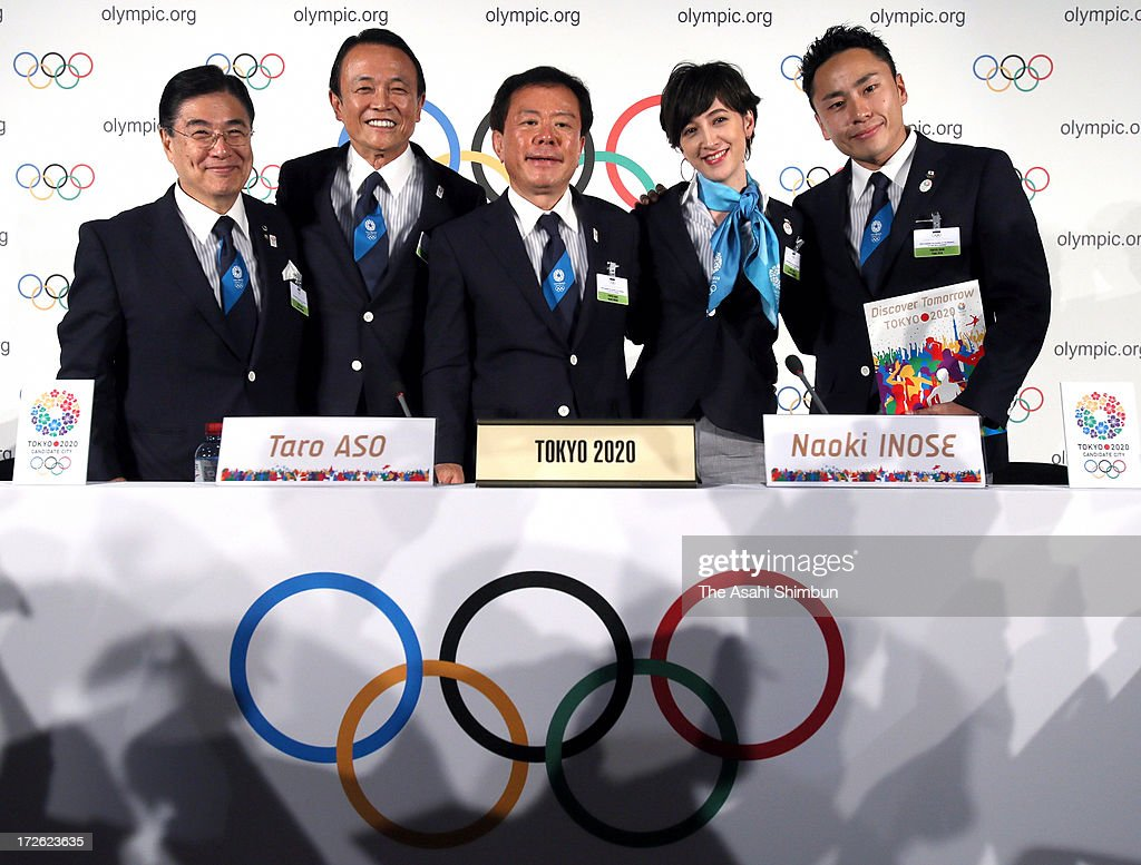 Tokyo 2020 vice president <a gi-track='captionPersonalityLinkClicked' href=/galleries/search?phrase=Masato+Mizuno&family=editorial&specificpeople=714172 ng-click='$event.stopPropagation()'>Masato Mizuno</a>, Japanese deputy prime minister <a gi-track='captionPersonalityLinkClicked' href=/galleries/search?phrase=Taro+Aso&family=editorial&specificpeople=559212 ng-click='$event.stopPropagation()'>Taro Aso</a>, Tokyo Governor Naoki Inose, TV presenter Christel Takigawa and fencing silver medalist <a gi-track='captionPersonalityLinkClicked' href=/galleries/search?phrase=Yuki+Ota&family=editorial&specificpeople=2956051 ng-click='$event.stopPropagation()'>Yuki Ota</a> pose for photographs after their bid presentation on July 3, 2013 in Lausanne, Switzerland.