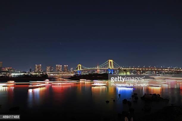 Tokyo Bay skyline with Rainbow Bridge and boats