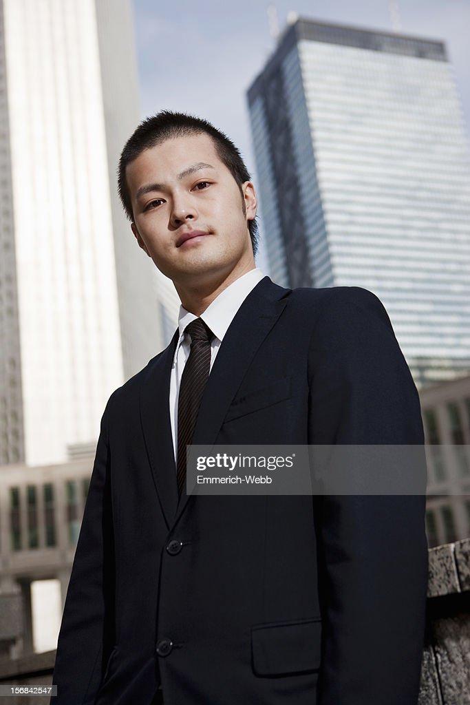 Tokyo Business Man in city surroundings : Stock Photo