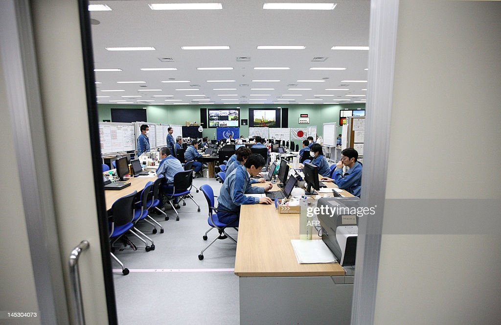 Tokyo Electric Power Co. (Tepco) employees work at the emergency operations center in the Seismic Isolated Building at the company's Fukushima Dai-Ichi nuclear power plant in Okuma Town, Fukushima Prefecture on May 26, 2012. Prior to tsunami-sparked meltdowns at Fukushima, resource-poor but energy-hungry Japan relied on nuclear for about a third of its electricity needs, a figure policymakers intended to boost to 50 percent. But since the accident, increasing public distrust has meant reactors shuttered for routine safety checks have not been allowed to restart, such that the country's entire stable is now offline. AFP PHOTO / Tomohiro Ohsumi / POOL