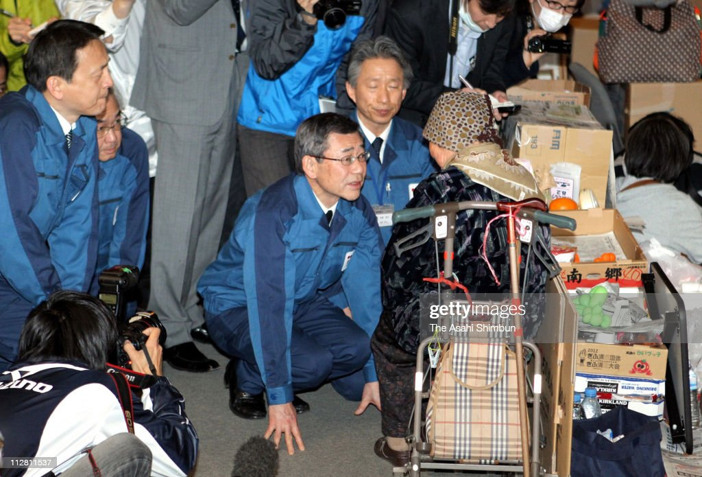 Tokyo Electric Power Co (TEPCO) President <a gi-track='captionPersonalityLinkClicked' href=/galleries/search?phrase=Masataka+Shimizu&family=editorial&specificpeople=6641912 ng-click='$event.stopPropagation()'>Masataka Shimizu</a> (C) kneels and bows to an evacuee in apology at an evacuation center on April 22, 2011 in Koriyama, Fukushima, Japan. The Japanese government prohibits entry without prior approval to the 20km deep exclusion zone around the troubled plant after raising the nuclear accident severity level to 7, the highest level on the International Nuclear Event Scale and the same level as the Chernobyl disaster in 1986. The Japanese government has ordered Tepco, the operator of the Fukushima Daiichi plant damaged by March 11 earthquake and tsunami, to compensate the 40,000 plus families living within the 30km radius of the plant approximately 1 million yen, which equates to 7,331GBP or 12,000USD per household starting on 28 April 2011.