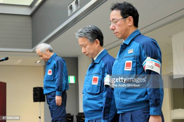 Tokyo Electric Power Co President Naomi Hirose and executives observe a minute of silence to commemorate victims at the Fukushima Daiichi Nuclear...