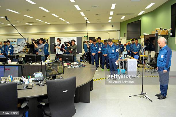 Tokyo Electric Power Co President Naomi Hirose and staffs observe a minute of silence at 246 pm when the Great East Japan Earthquake struck five...