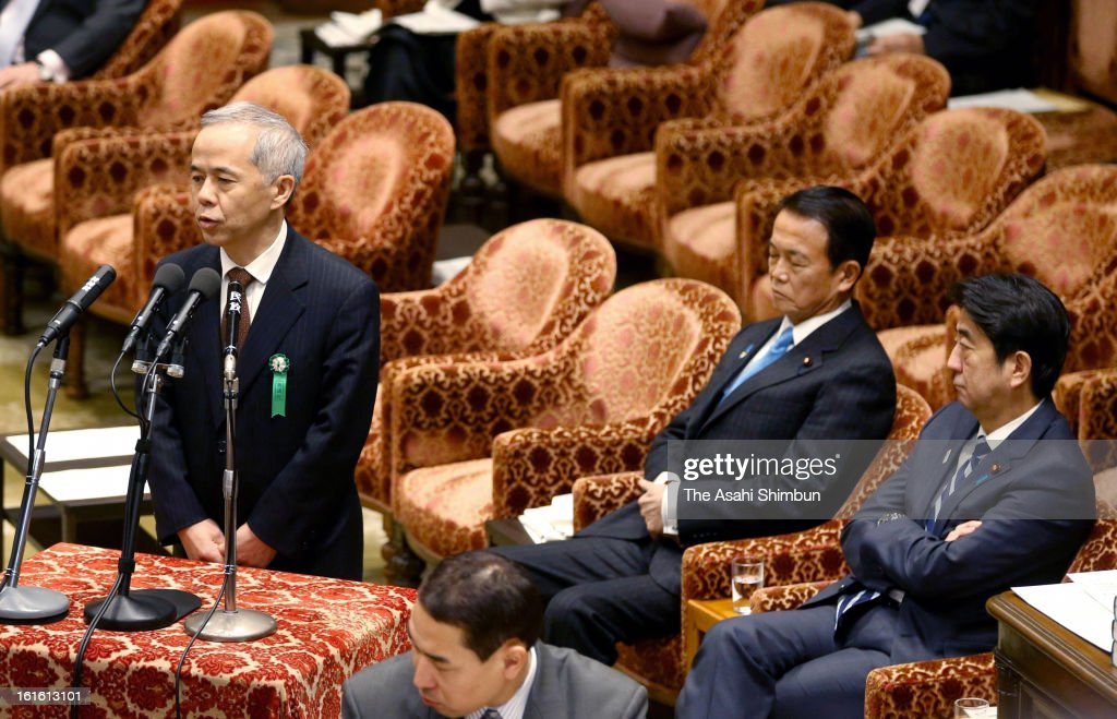 Tokyo Electric Power Co President Naomi Hirose (L) responds to questions while Japanese Prime Minister Shinzo Abe (R) and vice Prime Minister Taro Aso listen at the Lower House Budget Committee at the diet building on February 12, 2013 in Tokyo, Japan. TEPCO denied an organization-wide effort to interfere with a Diet investigation into the crippled Fukushima nuclear plant, saying one official was responsible for spreading misleading information.
