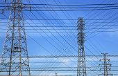 Tokyo Electric Power Co's Power transmission lines run from electricity pylons in Souka city Saitama prefecutre Japan Nov 14 2013 Photo by Haruyoshi...
