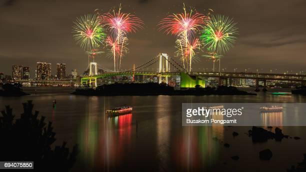 Tokyo firework at Tokyo bay and Rainbow bridge at night
