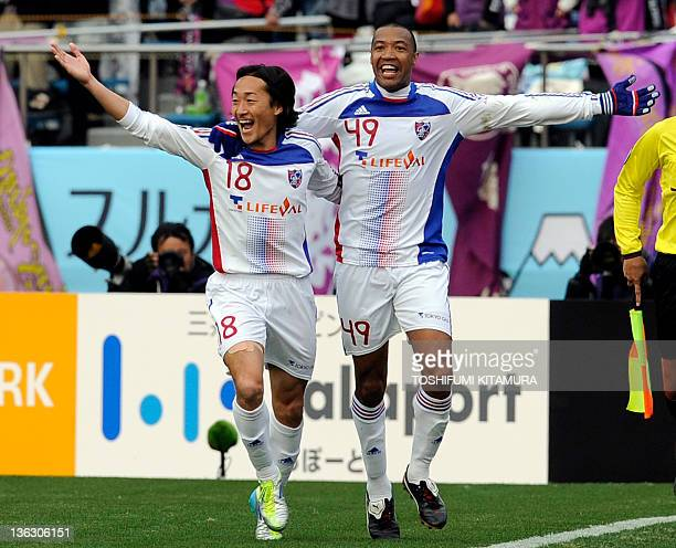 FC Tokyo forward Lucas celebrates his goal with Naohiro Ishikawa during the 91st Emperor's Cup football final against Kyoto Sanga FC in Tokyo on...