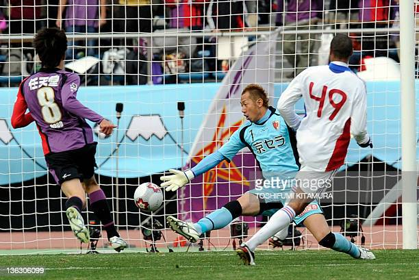 FC Tokyo forward Lucas shoots to score a goal past Kyoto Sanga FC goalkeeper Yuichi Mizutani during the 91st Emperor's Cup football final in Tokyo on...
