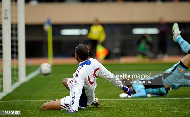 FC Tokyo forward Lucas watches the ball headed to the goal past Kyoto Sanga FC goalkeeper Yuichi Mizutani during the 91st Emperor's Cup football...