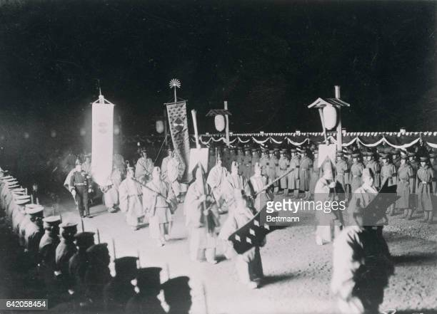 Funeral Photo shows bearers of the Sacred Sun Flag and the Sacred Moon Flag marching the process from Asakawa Station to the Mausoleum The Sun Flat...