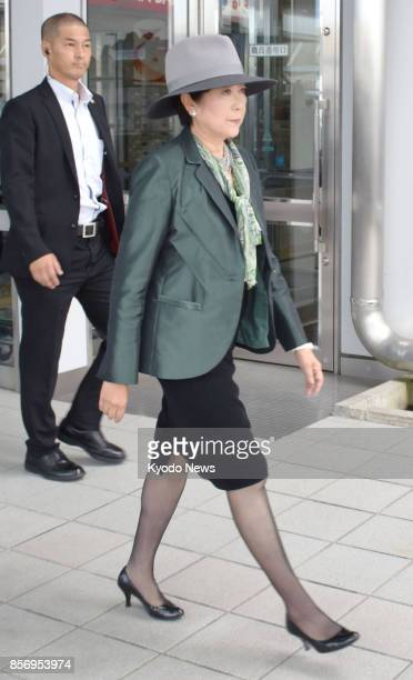 Tokyo Gov Yuriko Koike arrives at Kagoshima airport in southwestern Japan on Oct 3 to attend an advertising event for the 2020 Tokyo Olympics and...