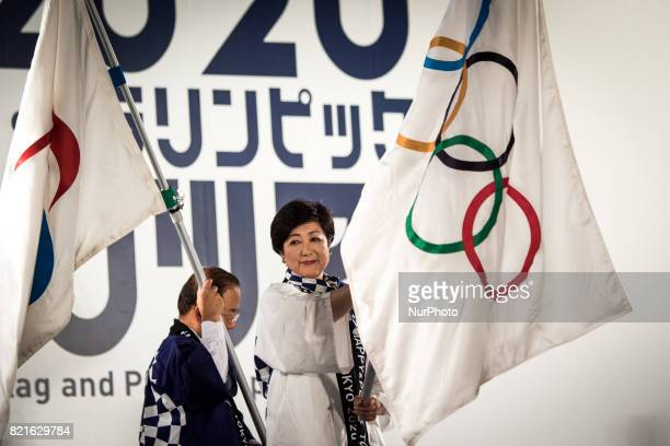 Tokyo Gov Yuriko Koike carries an Olympic flag during the Tokyo 2020 flag tour festival for the 2020 Games at Tokyo Metropolitan Plaza in Tokyo July...