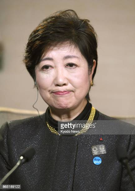 Tokyo Gov Yuriko Koike head of the new Party of Hope appears dispirited during a TV interview in Paris on Oct 22 after her party performed poorly in...