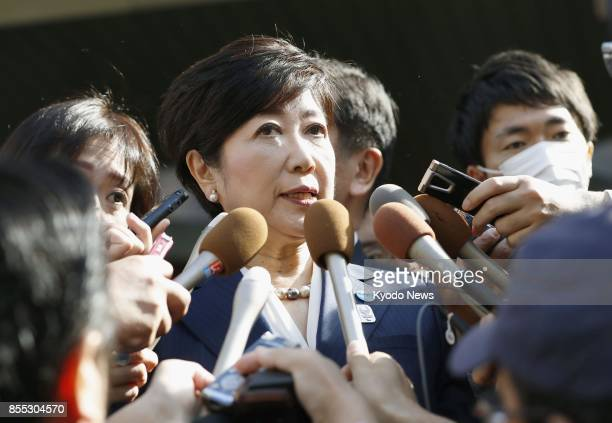 Tokyo Gov Yuriko Koike meets with reporters on Sept 29 in Tokyo after talking with main opposition Democratic Party leader Seiji Maehara The two...