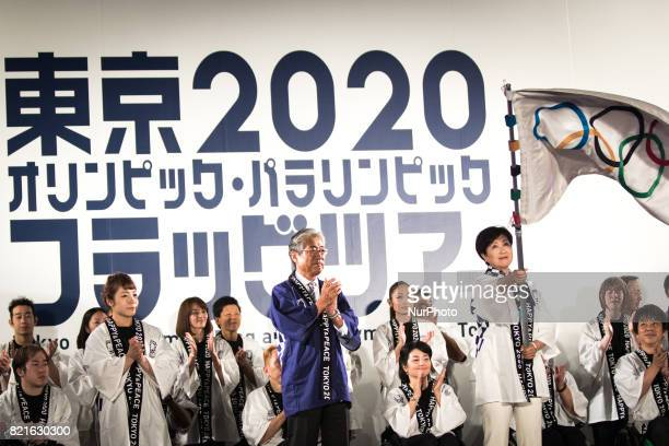 Tokyo Gov Yuriko Koike waves an Olympic flag applauded by Japanese athletes during the Tokyo 2020 flag tour festival for the 2020 Games at Tokyo...