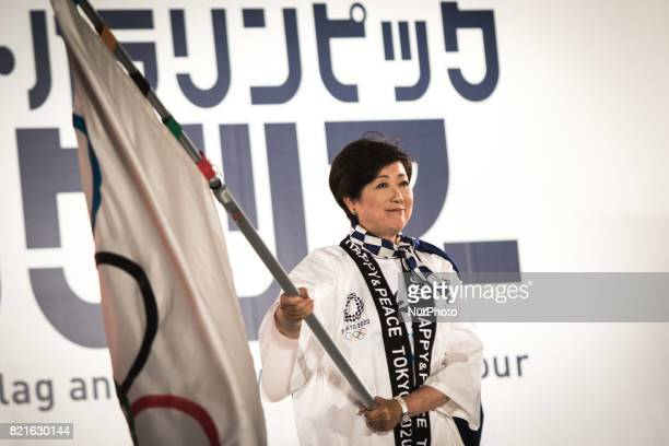 Tokyo Gov Yuriko Koike waves an Olympic flag during the Tokyo 2020 flag tour festival for the 2020 Games at Tokyo Metropolitan Plaza in Tokyo July 24...