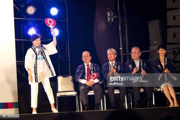Tokyo Gov Yuriko Koike waves to public before her speech with the hosts and guests Toshiro Muto Tsunekazu Takeda Mitsunori Torihara Tamayo Marukawa...