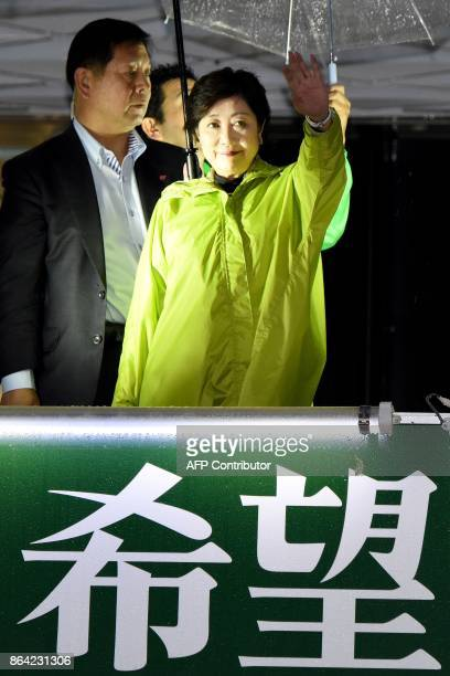 Tokyo Governor and leader of the Party of Hope Yuriko Koike waves from a campaign car on the last day of campaigning for the general elections in...