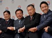 Tokyo Governor Naoki Inose shakes hands with Olympic bid committee members Masato Mizuno Yoshiro Mori and Yuki Ota at a press conference at the Tokyo...