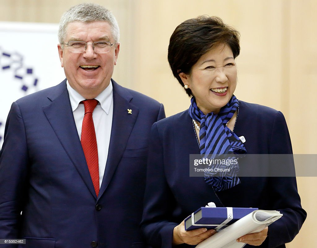 Tokyo Governor Yuriko Koike (R) and President of the International Olympic Committee Thomas Bach smile after their meeting at the Tokyo Metropolitan Government Office on October 18, 2016 in Tokyo, Japan. Bach and Koike are expected to discuss a proposed shift of the rowing/canoe sprint events to Miyagi Prefecture, as the governor's attempt to prevent the budget for the Tokyo Games from increasing.