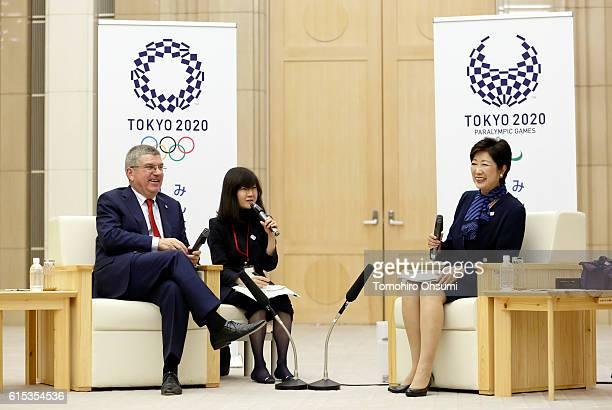 Tokyo Governor Yuriko Koike and President of the International Olympic Committee Thomas Bach smile during a meeting at the Tokyo Metropolitan...