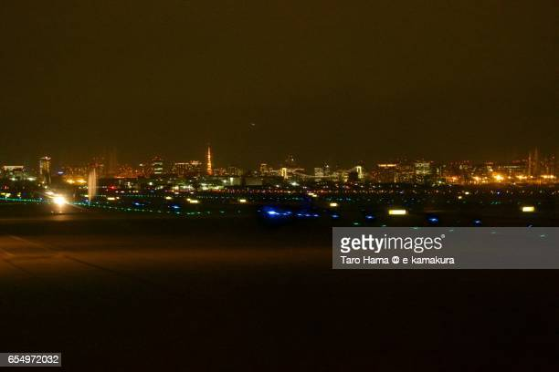 Tokyo Haneda International Airport and Tokyo city, night time aerial view from airplane