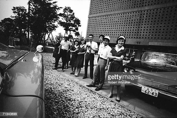 Tokyo Hilton staff line up to send the Beatles off on their trip towards the Budokan Hall during the band's tour of Asia 1966
