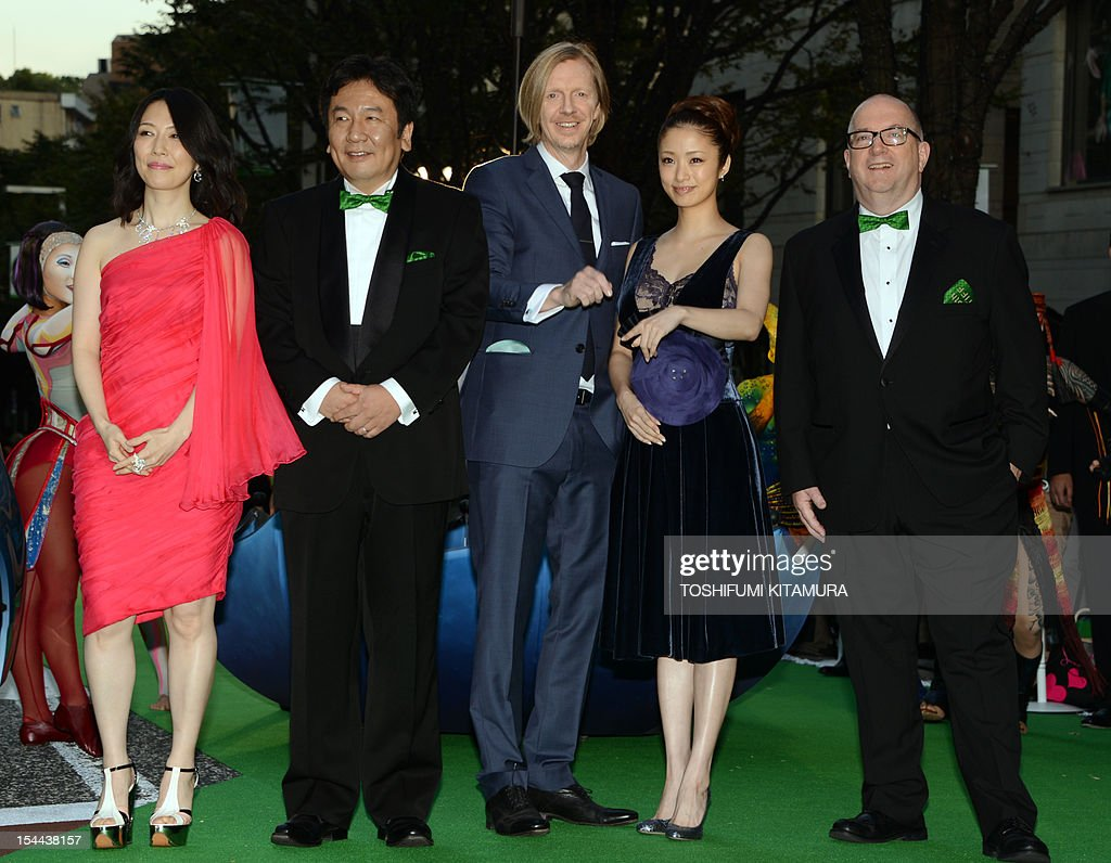 Tokyo International Film Festival (TIFF) opening movie, 'Cirque du soleil: Worlds Away' director Andrew Adamson (C) poses with executive producer Jacques Methe (R), actress and Japan's official navigator Aya Ueto (2nd R), poster designer Hina Aoyama (L) and Economy, Trade and Industry Minister Yukio Edano (2nd L) during the festival's opening ceremony in Tokyo on October 20, 2012. With China's main entry to the film festival being pulled, a total of 103 movies will be screened during the nine-day event.