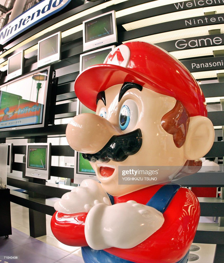 A large mascot of Japanese video game giant Nintendo's popular game character Super-Mario stands at a showroom in Tokyo, 25 May 2006. Nintendo said its consolidated net profit climbed 12.5 percent to 98.38 billion yen (894 million USD) and pretax profit moved up 10.6 percent to 160.76 billion yen (1.46 billion USD) in the year ended 31 March. AFP PHOTO/YOSHIKAZU TSUNO