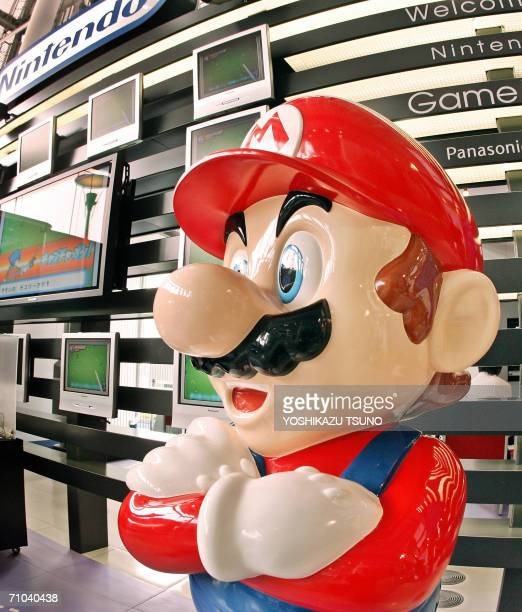 A large mascot of Japanese video game giant Nintendo's popular game character SuperMario stands at a showroom in Tokyo 25 May 2006 Nintendo said its...
