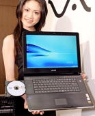 A model displays the world's first notebook PC produced by Japanese electronics giant Sony with a Bluray disk drive 'Vaio type A' equipped with an...