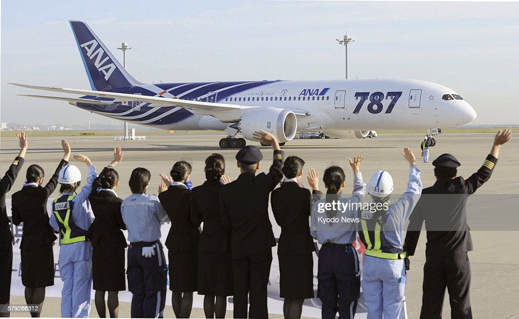 Tokyo Japan All Nippon Airways Co's workers at Haneda airport in Tokyo wave at the airline's Boeing 787 Dreamliner jet about to take off for the...