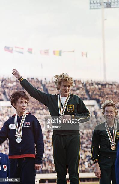 Betty Cuthbert Olympic athlete in center after taking first place in the women's 400 meter run In seciond place at left is Ann Packer of Great...