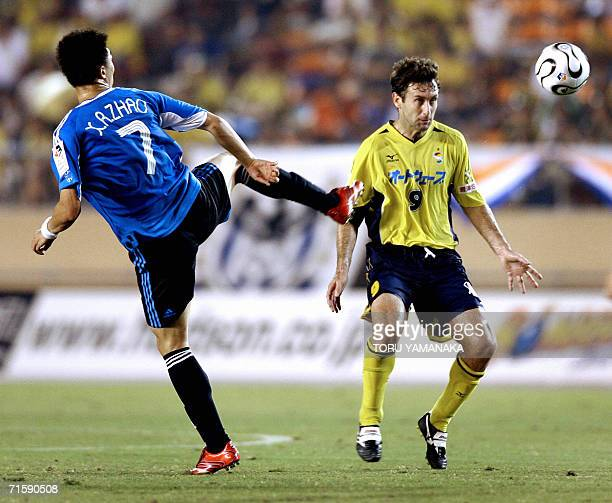 China's Dalian Shide midfielder FC Zhao Xu Ri battles for the ball with Japanese club JEF United Chiba midfielder Nebojsa Krupnikovic during their...